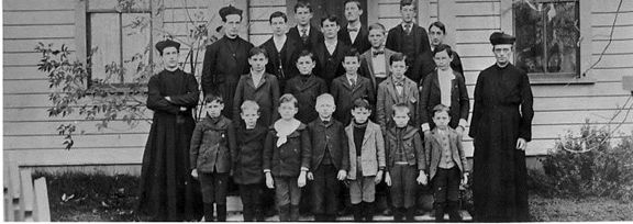 Teachers and Children of Early Catholic School