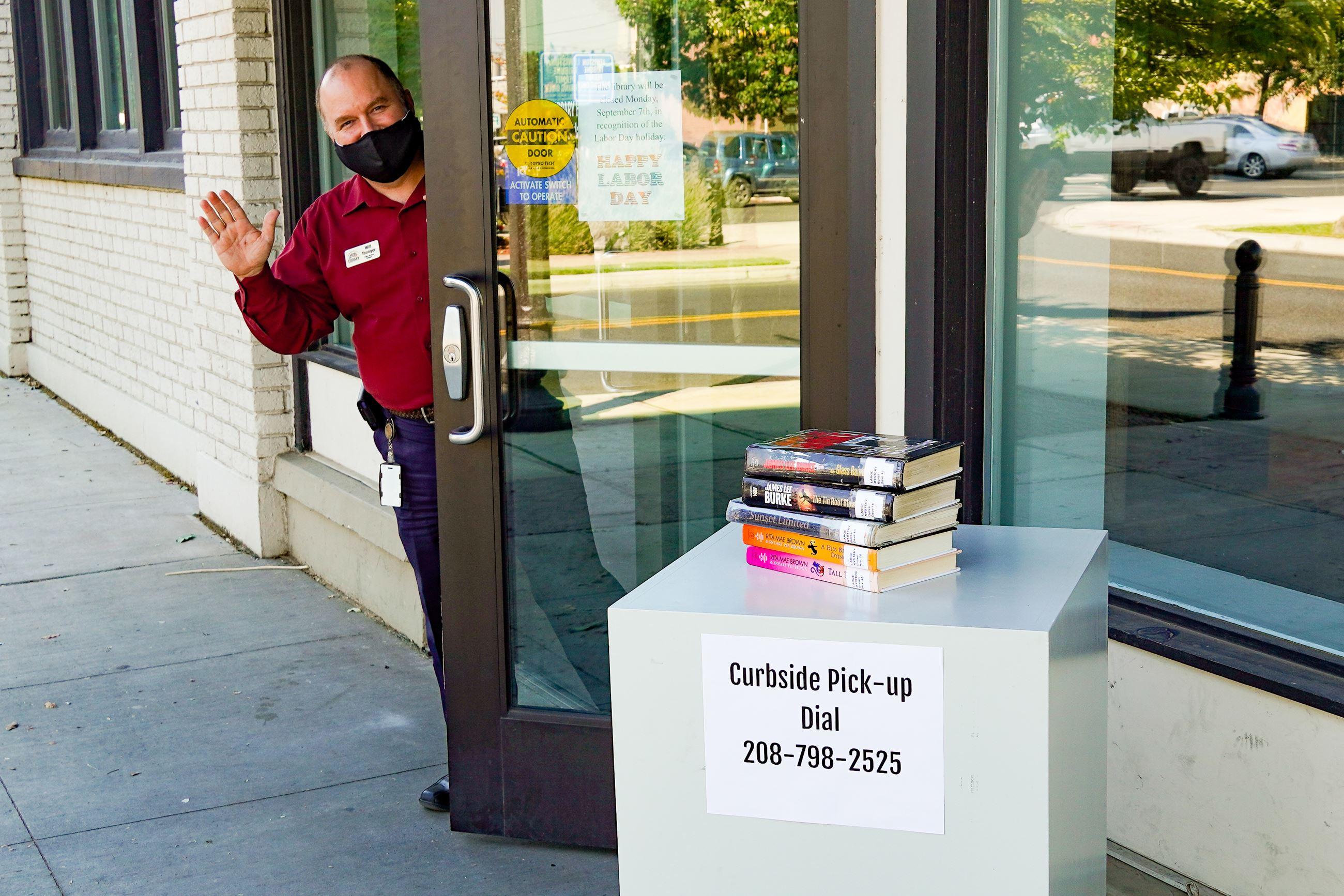 Public Services Manager brings books to curbside pick-up